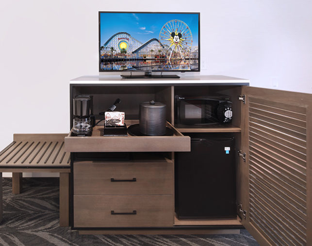 Cabinet with TV, mini fridge, microwave and coffeemaker