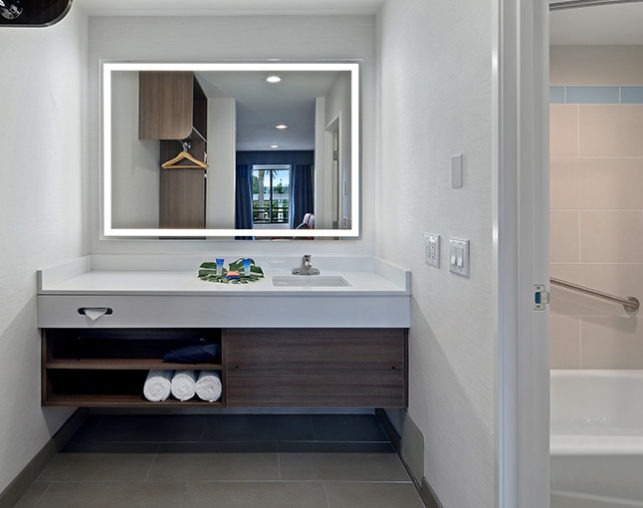 Bathroom vanity with custom bath amenities and LED mirror