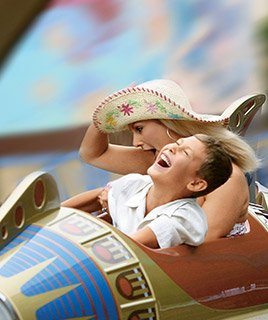 Mother and Son laughing on a space themed ride in Disneyland