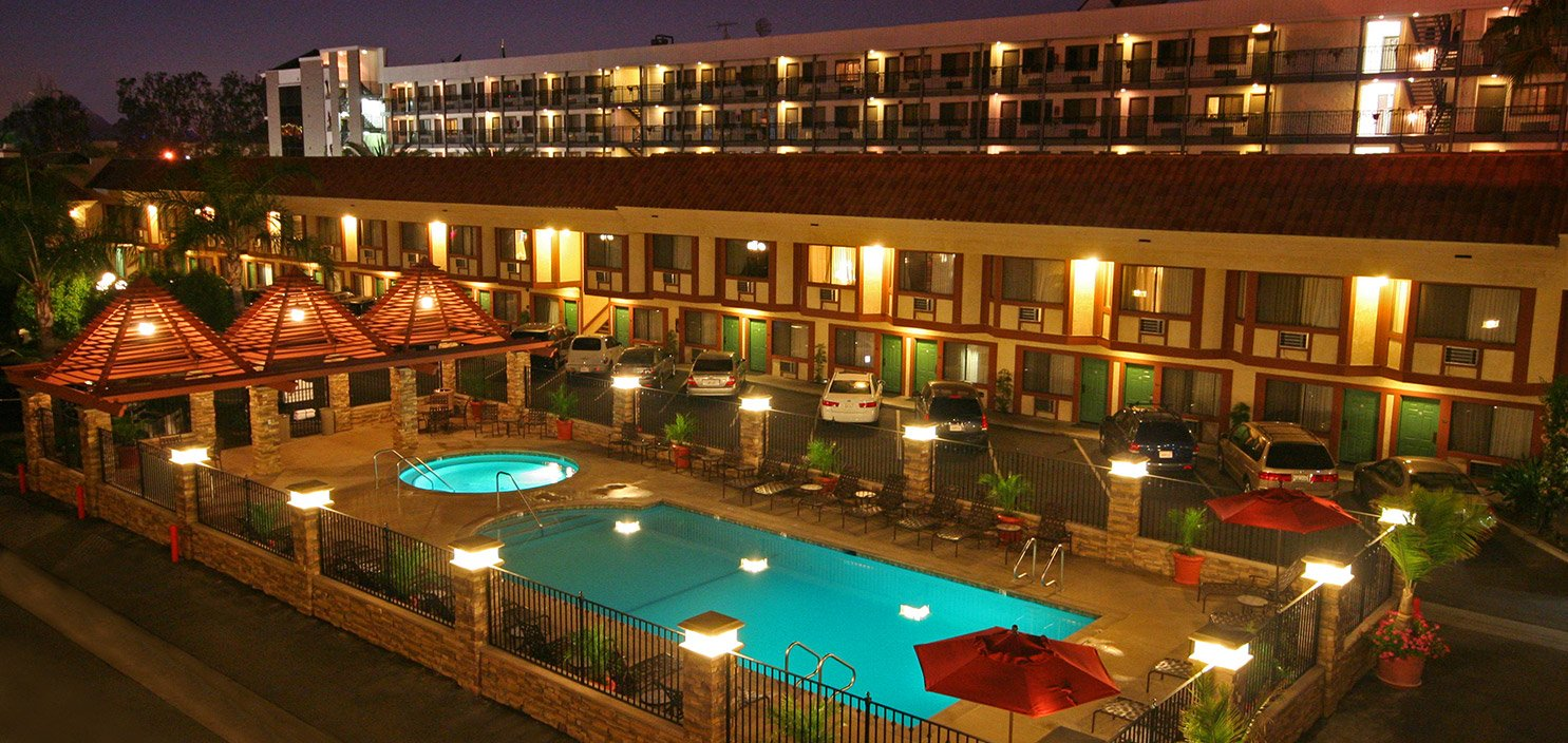 View of Tropicana Inn & Suites and pool at night