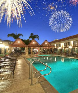 Fireworks over the pool and hotel of Tropicana Inn