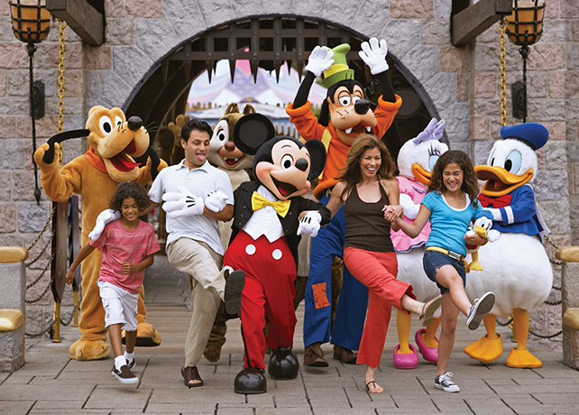 family walking with disney characters