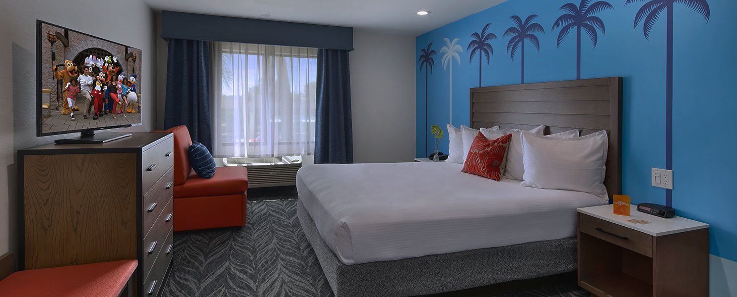 The Executive suite with a large bed and a large TV at the Tropicana Inn and Suites in Anaheim