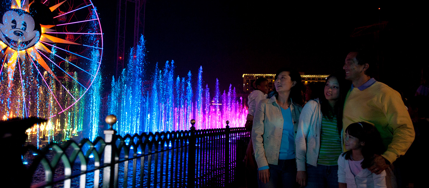 Family watching World of Color at Disneyland® California Adventure