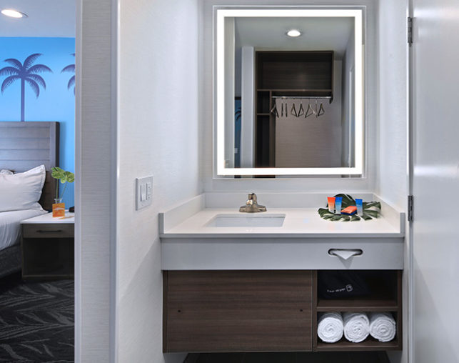 The Park View Suite at the Tropicana Inn & Suites features a bathroom with separate vanity area