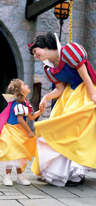 Woman and Young Girl Dressed as Snow White yellow and blue dress