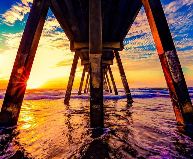 View of Ocean Sunset under Pier