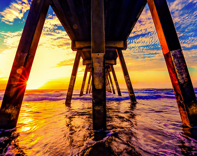 View from under a pier at sunset