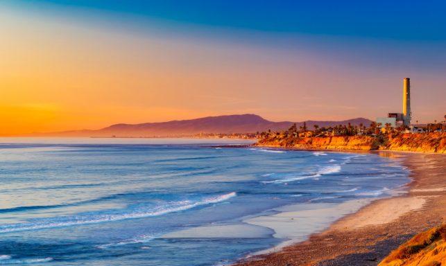 Sunset photo of the California beach shoreline.