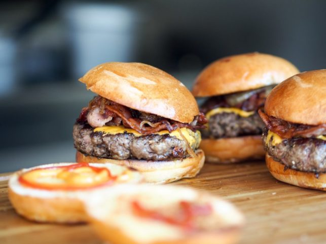 juicy burgers with cheese and carmelized onion