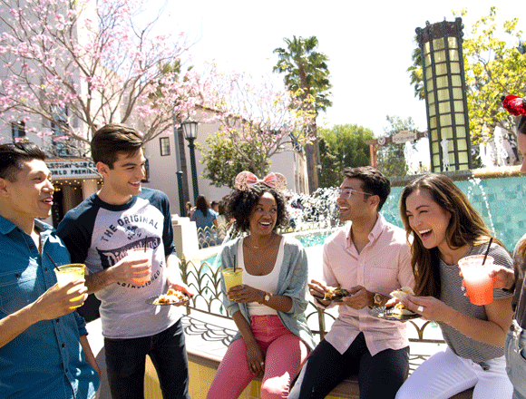 friends at Disneyland Park with treats laughing