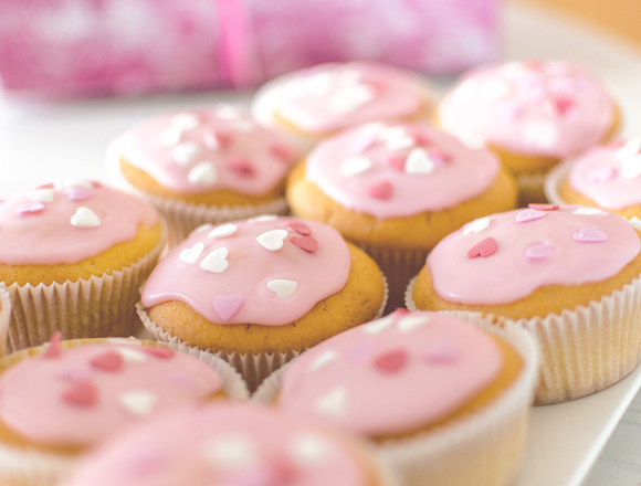 pink frosted cup cakes
