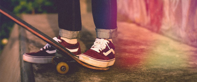foot wearing vans on skateboard