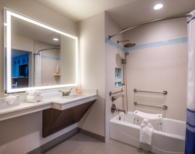 Side view of our ADA bathroom with shower/tub combo at our hotel near Disneyland®