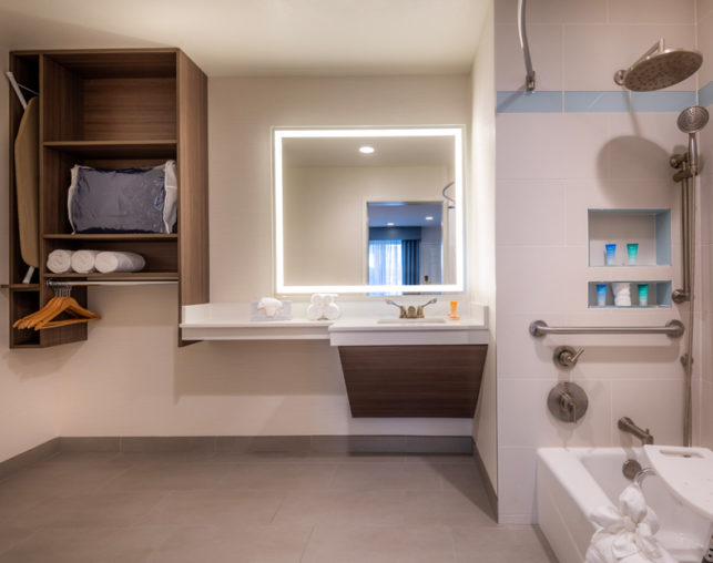 ADA king guest room with shower/tub combo and shower chair at our Anaheim hotel