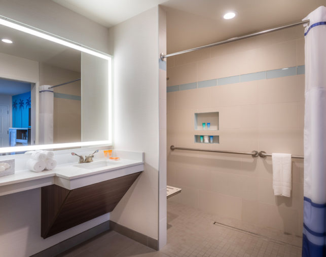 Wide view of King ADA roll in shower at Tropicana Inn & Suites