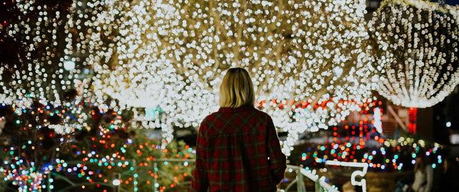 woman looking at christmas lights